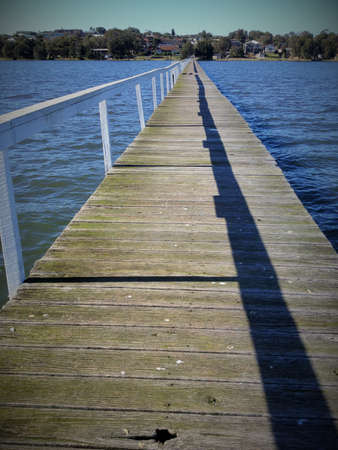 focal: jetty long water to focal point shadow of handrail