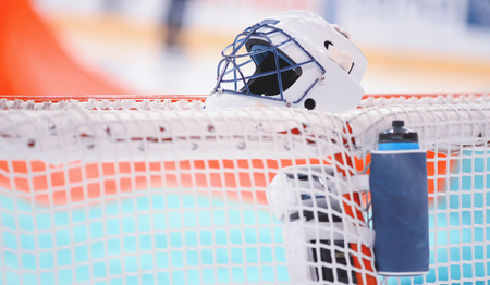 Goaltenders ammunition - helmet and bottle before the game on the gate net