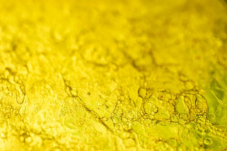 Bubble abstract yellow lubricant gel texture. Viscous petrolatum - macro photo Imagens - 100905547