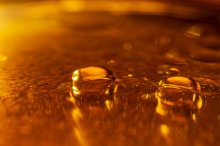 Oil drops and bubbles on a metal gear engine surface. Closeup photo. Stock Photo