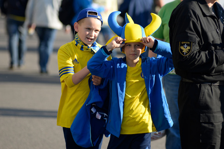 MINSK, BELARUS - MAY 23, 2018: Little fans having fun before the Belarusian Premier League football match between FC Dynamo Minsk and FC Bate at the Tractor stadium. Editorial