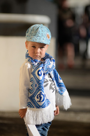 MINSK, BELARUS - MAY 23, 2018: Little fans looks before the Belarusian Premier League football match between FC Dynamo Minsk and FC Bate at the Tractor stadium.