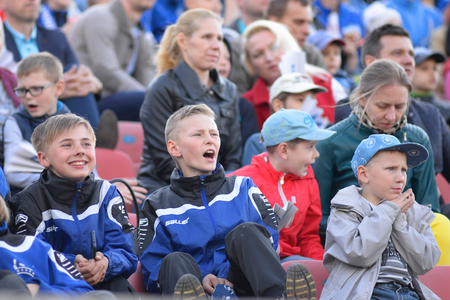 MINSK, BELARUS - MAY 23, 2018: Little fans having fun during the Belarusian Premier League football match between FC Dynamo Minsk and FC Bate at the Tractor stadium.