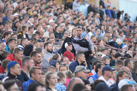 MINSK, BELARUS - MAY 23, 2018: Parents and child are looking for a place before the Belarusian Premier League football match between FC Dynamo Minsk and FC Bate at the Tractor stadium.