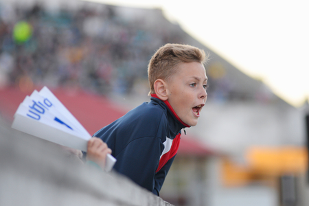 MINSK, BELARUS - MAY 23, 2018: Little fan react during the Belarusian Premier League football match between FC Dynamo Minsk and FC Bate at the Tractor stadium.