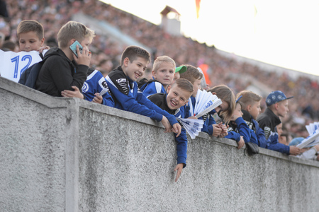 MINSK, BELARUS - MAY 23, 2018: Little fans react during the Belarusian Premier League football match between FC Dynamo Minsk and FC Bate at the Tractor stadium.