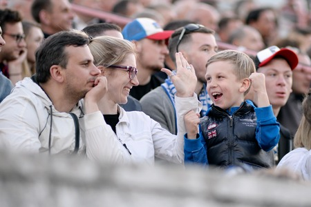 MINSK, BELARUS - MAY 23, 2018: Happy family celebrates victory during the Belarusian Premier League football match between FC Dynamo Minsk and FC Bate at the Tractor stadium.