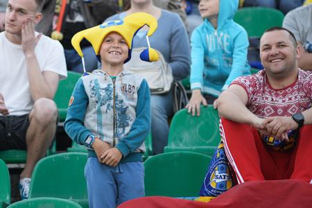 MINSK, BELARUS - MAY 23, 2018: Little fan having fun during the Belarusian Premier League football match between FC Dynamo Minsk and FC Bate at the Tractor stadium.