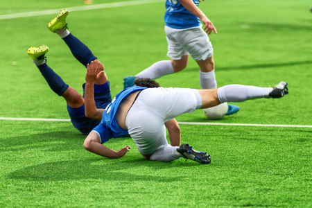 Soccer players play bad football. A footballer is injured during a violation of the rules of the game. Team leaves the competition.
