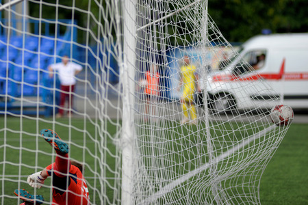 MINSK, BELARUS - JUNE 29, 2018: Goal - a soccer ball flies into the gates net during the Belarusian Premier League football match between FC Luch and FC BATE at the Olimpiyskiy stadium.