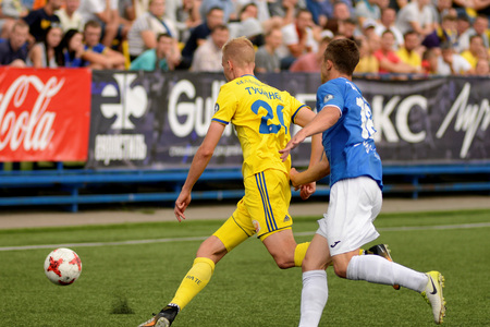 MINSK, BELARUS - JUNE 29, 2018: Soccer players fights for ball during the Belarusian Premier League football match between FC Luch and FC BATE at the Olimpiyskiy stadium.