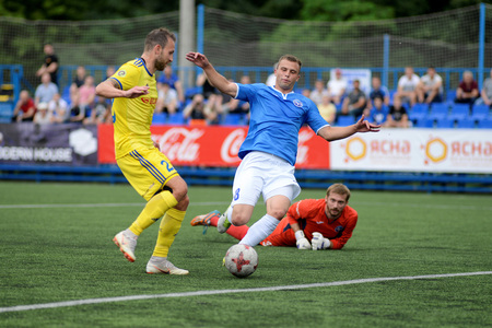 MINSK, BELARUS - JUNE 29, 2018: soccer player scores a goal during the Belarusian Premier League football match between FC Luch and FC BATE at the Olimpiyskiy stadium.
