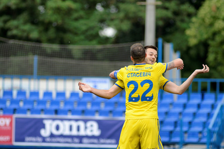 MINSK, BELARUS - JUNE 29, 2018: Soccer players celebrate goal during the Belarusian Premier League football match between FC Luch and FC BATE at the Olimpiyskiy stadium. Editorial