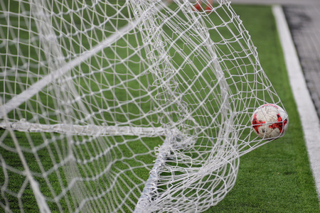 MINSK, BELARUS - JUNE 29, 2018: Goal - a soccer ball flies into the gates net during the Belarusian Premier League football match between FC Luch and FC BATE at the Olimpiyskiy stadium. Stock Photo - 123677528