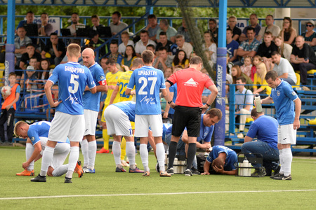 MINSK, BELARUS - JUNE 29, 2018: footballer is injured during the Belarusian Premier League football match between FC Luch and FC BATE at the Olimpiyskiy stadium.