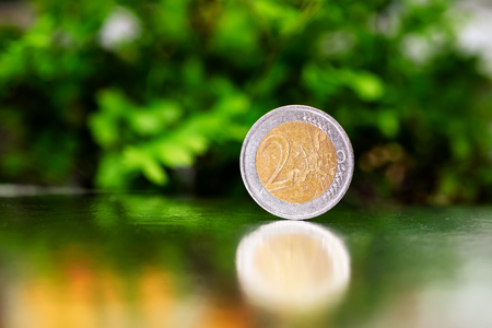 two euro coin closeup on silver and green background. Banque d'images