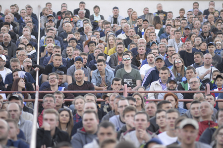 MINSK, BELARUS - MAY 23, 2018: Fans looks game during the Belarusian Premier League football match between FC Dynamo Minsk and FC Bate at the Tractor stadium.