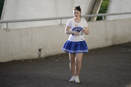 MINSK, BELARUS - MAY 23, 2018: football cheerleader looks during the Belarusian Premier League football match between FC Dynamo Minsk and FC Bate at the Tractor stadium. Editorial