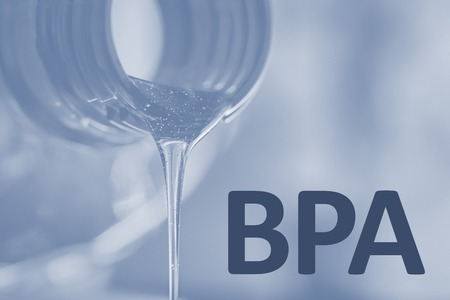 Plastic bottle and liquid stream. Bisphenol, text BPA FREE plastic photo.