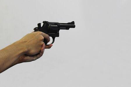 A man firing a short gun in the shooting range Banco de Imagens