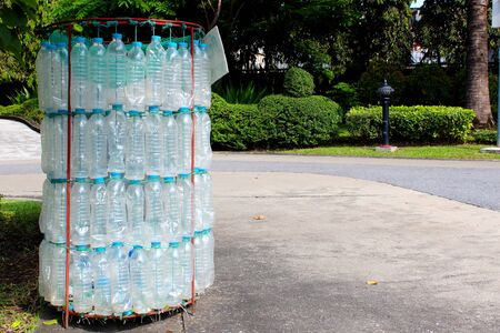 Recycle bins made from plastic water bottles placed in the park Stock Photo