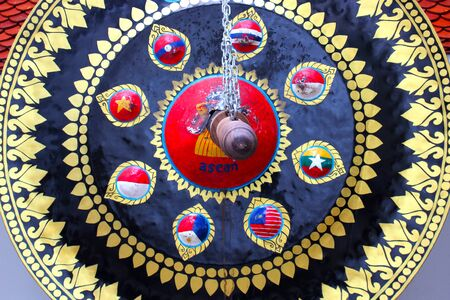 Big black gong decorated with Thai motifs, hung in Thai temple, Bangkok, Thailand