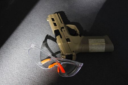 Short gun  for practice shooting and goggles for protecting the eyes