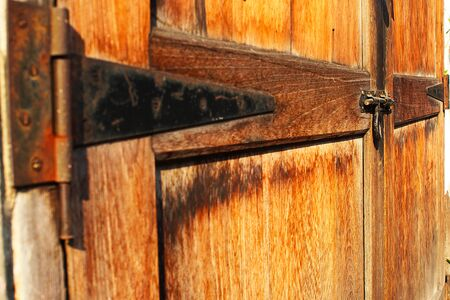The hasp of the old wooden doors of Chinese house in the Chinatown at Bangkok, Thailand