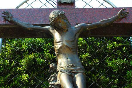 Statue of Jesus Christ on the Cross at a Roman Catholic Church in Bangkok, Thailand Banco de Imagens