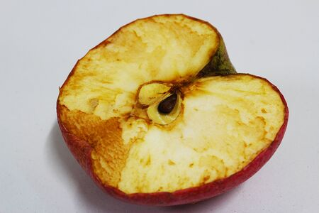 Half an apple that starts to wither