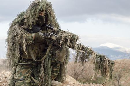 Sniper camouflage ghilliekostuum Stockfoto