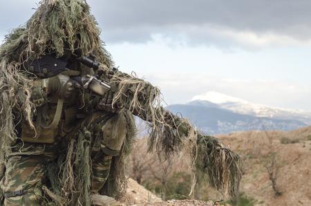 recon: Sniper ghillie suit recon Stock Photo