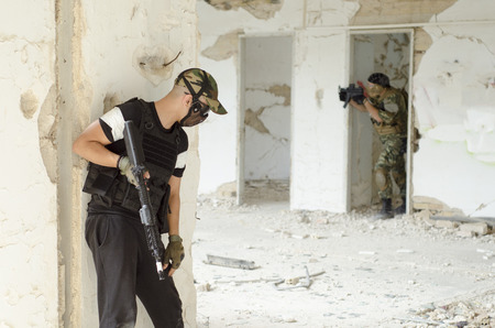 Masked airsoft soldier inside building