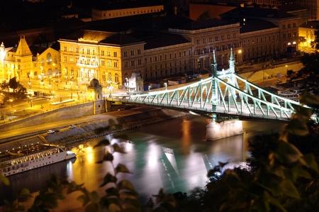 night view of bridge over Danube, Budapest photo