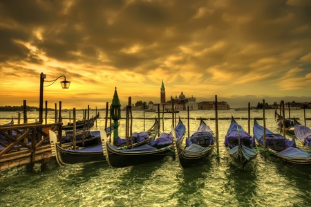 venice dark scene with gondolas at sunset