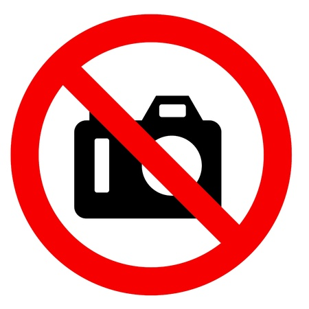 public safety: No photography sign