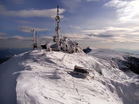 Weather station in the mountains after a winter storm photo
