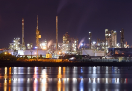 night scene of petrochemical plant with water reflection photo