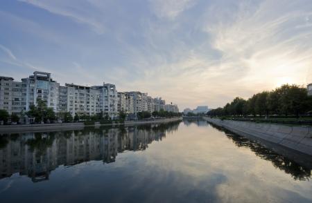 bucuresti: Dambovita river and buildings reflected in water, Bucharest  Romania Stock Photo