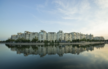 bucharest: Dambovita river and buildings reflected in water, Bucharest  Romania Stock Photo