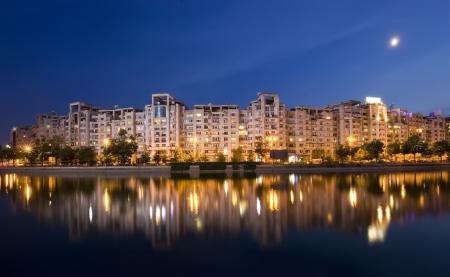 bucuresti: Dambovita river and buildings reflected in water, Bucharest  Romania  night scene Stock Photo