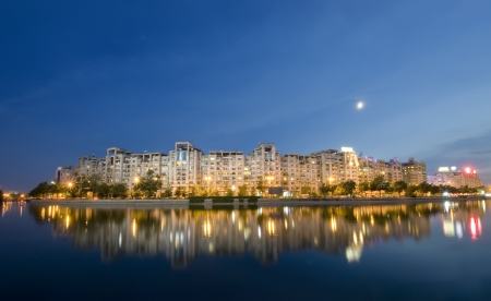Bucharest night scene with Dambovita river and moon. Romania Banco de Imagens