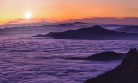 Romanian landscape in Carpathians with mystic cloud sea  photo
