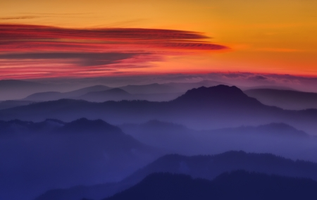 mystic red mountain sunset with fog photo