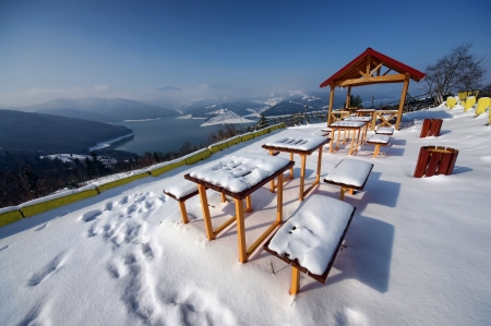 touristic resting place covered in snow, Romania photo