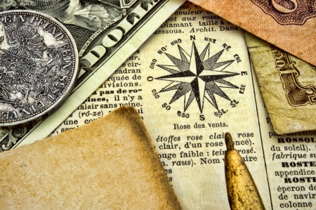 Compass, old documents and money on paper photo
