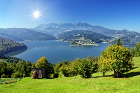 fresh autumn landscape with Carpathian mountain and lake, Romania