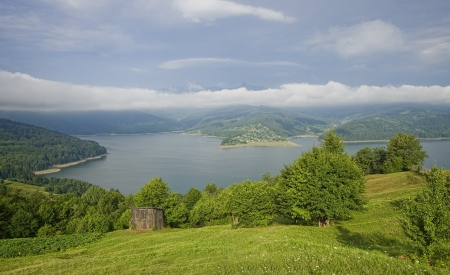 fresh landscape of mountain clouds and lake photo