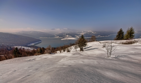 Romanian Carpathians winter landscape, Bicaz lake view photo