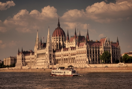 old style photo, sunset at Budapest Parliament, Hungary photo
